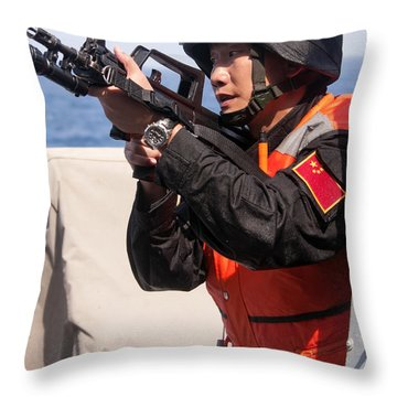 A Member Of The Chinese Peoples Throw Pillow by Stocktrek Images