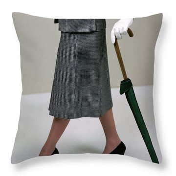 A Model Holding An Umbrella Throw Pillow