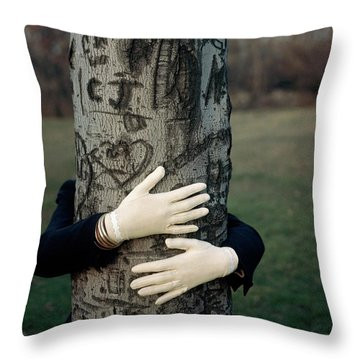 A Model Hugging A Tree Throw Pillow