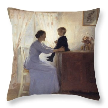 A Mother And Child In An Interior Throw Pillow by Peter Vilhelm Ilsted