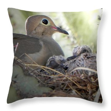 Throw Pillow featuring the photograph A Mothers' Love by Deb Halloran