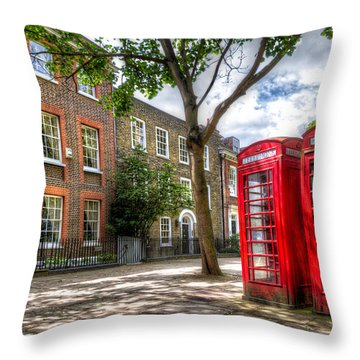 A Pair Of Red Phone Booths Throw Pillow by Tim Stanley