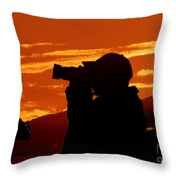 Throw Pillow featuring the photograph A Photographer Enjoying His Work by Kathy Baccari