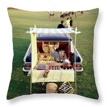 A Picnic Table Set Up On The Back Of A Car Throw Pillow