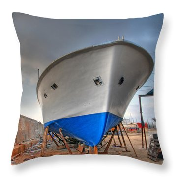 Throw Pillow featuring the photograph a resting boat in Jaffa port by Ron Shoshani