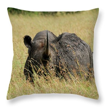 A Rhino Standing In The Grass Throw Pillow
