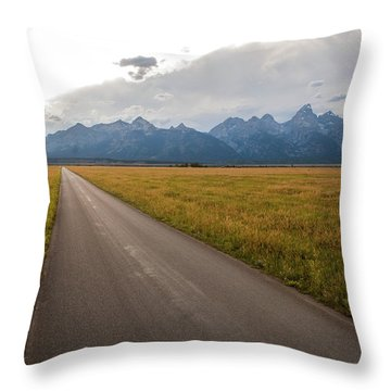 A Road Leading Toward The Grand Teton Throw Pillow