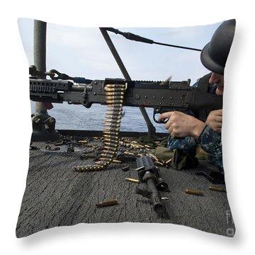 A Sailor Fires An M-240b Machine Gun Throw Pillow by Stocktrek Images