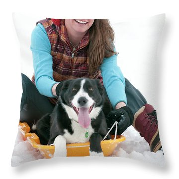 A Smiling Young Woman Rides A Sled Throw Pillow