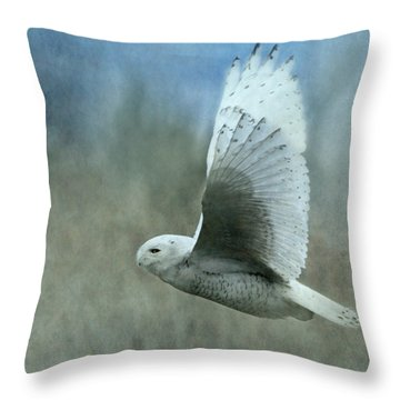 A Snowy Flight Throw Pillow by Angie Vogel