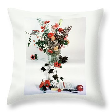 A Studio Shot Of A Vase Of Flowers And A Garden Throw Pillow