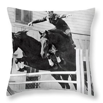 A Stunt Rider On Two Horses. Throw Pillow