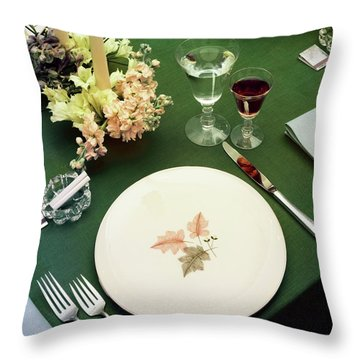 A Table Setting On A Green Tablecloth Throw Pillow