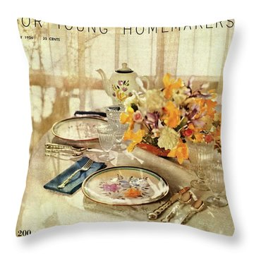 A Table Setting With A Floral Centerpiece Throw Pillow