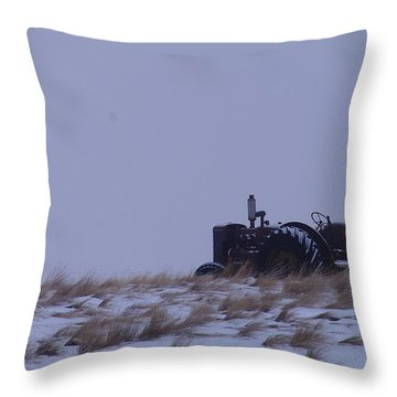 A Tractor Fading To The Snow  Throw Pillow by Jeff Swan