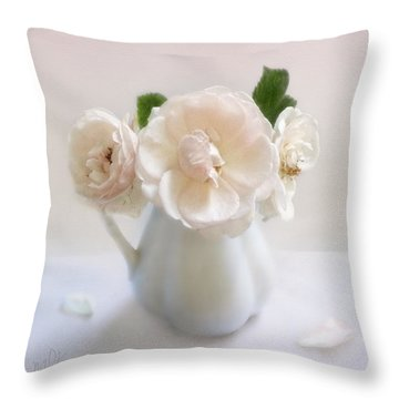 Throw Pillow featuring the photograph A Trio Of Pale Pink Vintage Roses by Louise Kumpf