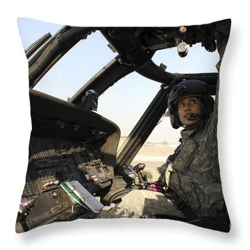 A Uh-60 Black Hawk Helicopter Throw Pillow by Stocktrek Images