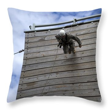 A U.s. Soldier Runs Down A 40-foot Throw Pillow by Stocktrek Images