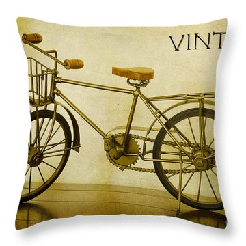 A Vintage Bike Throw Pillow by MaryJane Armstrong