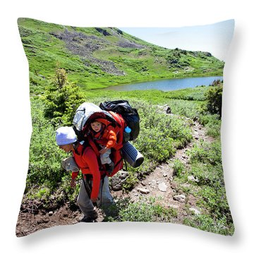 A Woman Hikes Above Tree Line Throw Pillow