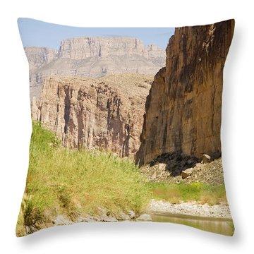A Woman Navigates Her Canoe Throw Pillow