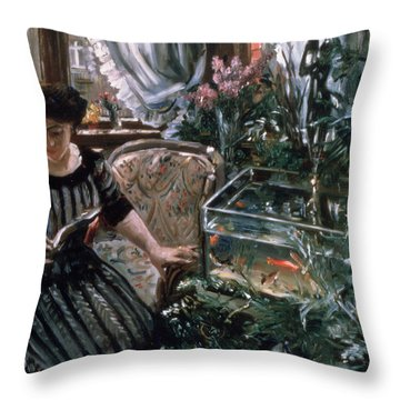 A Woman Reading Near A Goldfish Tank Throw Pillow