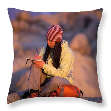 A Woman Sits And Writes In Her Journal Throw Pillow