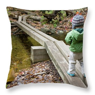 A Young Girl Walks Across Hiking Throw Pillow