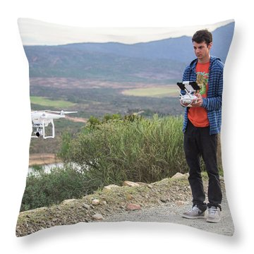 A Young Male Flies His Drone Throw Pillow