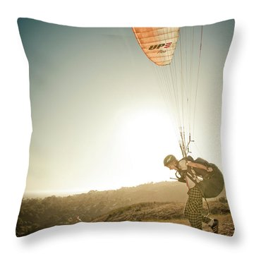 A Young Man Launches His Paraglider Throw Pillow