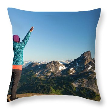 A Young Woman Celebrates After Reaching Throw Pillow