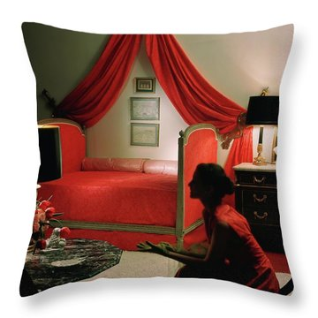 A Young Woman Sitting In A Red Bedroom Throw Pillow