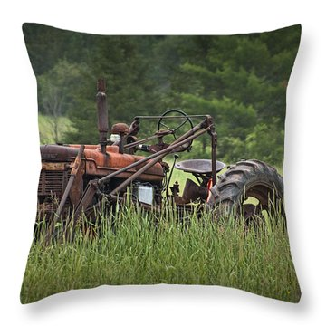 Abandoned Farm Tractor In The Grass Throw Pillow by Randall Nyhof