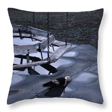 Abandoned Playground With Old Doll Left Behind Throw Pillow