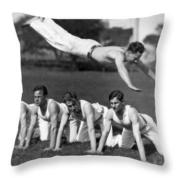 Acrobatic Swandive Throw Pillow by Underwood Archives
