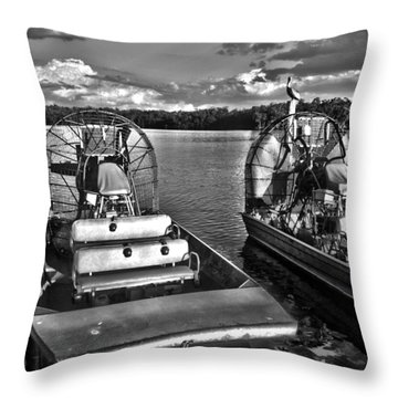 Airboats Throw Pillow by Timothy Lowry