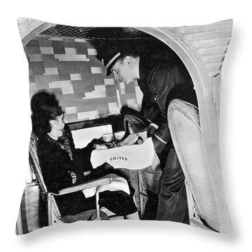 Airline Steward Serves Woman Throw Pillow