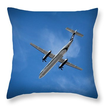 Airplanes Throw Pillow featuring the photograph Alaska Airlines Turboprop by Aaron Berg