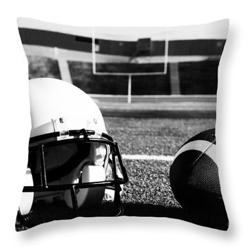 American Football And Helmet On Field Throw Pillow