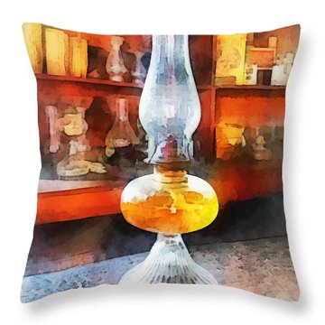 Americana - Hurricane Lamp In General Store Throw Pillow by Susan Savad