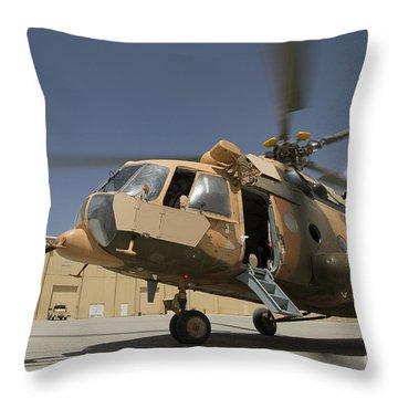 An Afghan Air Force Aerial Gunner Makes Throw Pillow