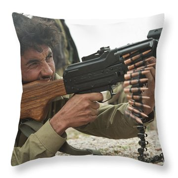 An Afghan Local Police Officer Fires Throw Pillow by Stocktrek Images