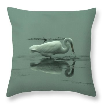 An Egret Feeding Throw Pillow by Jeff Swan