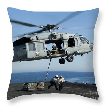 An Mh-60s Sea Hawk Helicopter Prepares Throw Pillow by Stocktrek Images