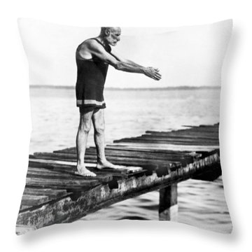 An Old Man Prepares To Dive Throw Pillow