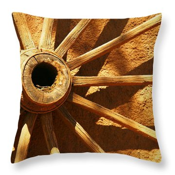 An Old Wagon Wheel In Carillos New Mexico Throw Pillow by Jeff Swan