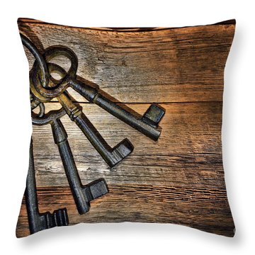 Antique Keys Throw Pillow by Olivier Le Queinec