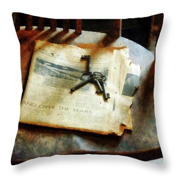 Throw Pillow featuring the photograph Antique Keys On Newspaper by Susan Savad
