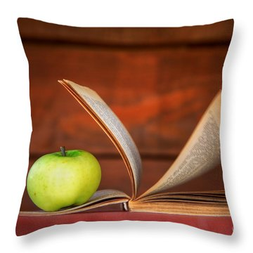 Apple And Book Throw Pillow by Michal Bednarek