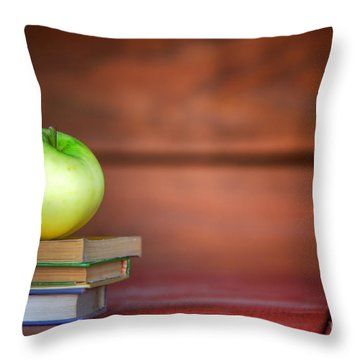 Apple On Pile Of Books Throw Pillow by Michal Bednarek
